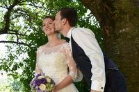 Groom in love is kissing the bride