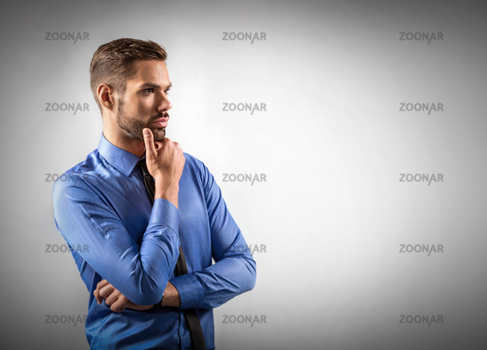 Young businessman thinking about new business ideas