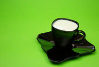 A cup of milk isolated green