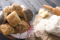 Basket with bread rolls and ingredients