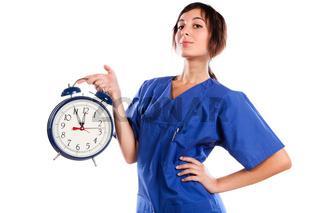 Young Beautiful Woman Holding A Big Alarm Clock
