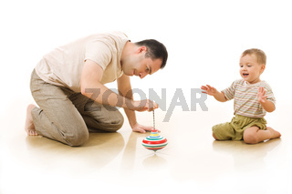 The man plays with his little son