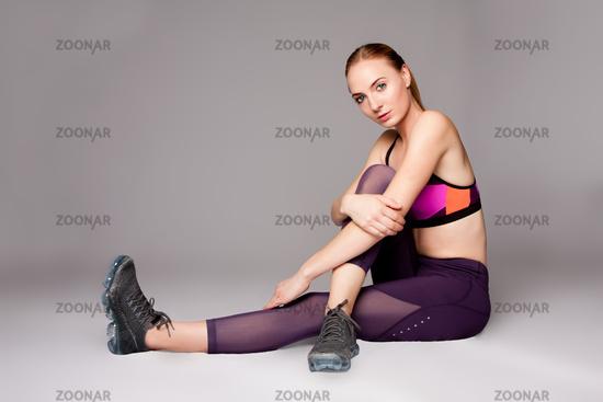 Beautiful Athletic woman sitting