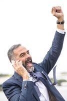Senior business man receiving fantastic news