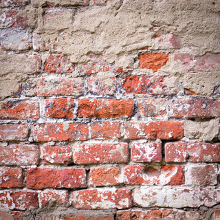Background of old vintage dirty brick wall
