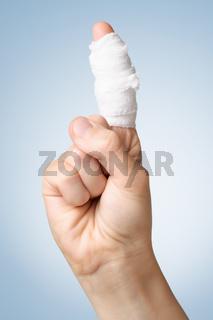 Injured finger with bandage