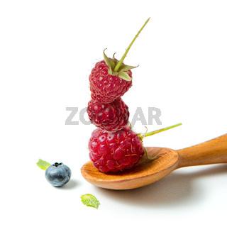 Raspberry in wooden spoon