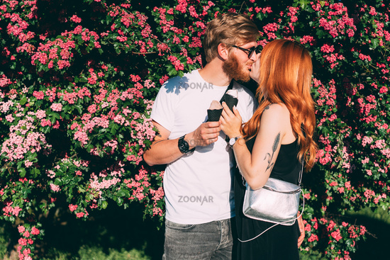 Couple in park eating ice cream cones