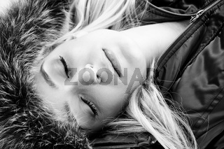 close view of beautiful face of woman with closed eyes