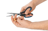 Hand with scissors and cigarette
