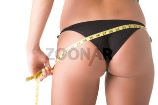 Woman in a Bikini Measuring Her Waist