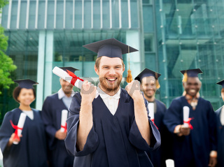 happy student with diploma celebrating graduation