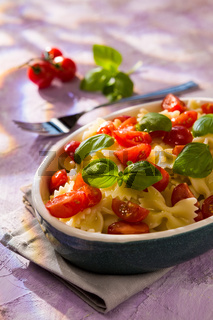 Italian Farfalle pasta with tomatoes and basil