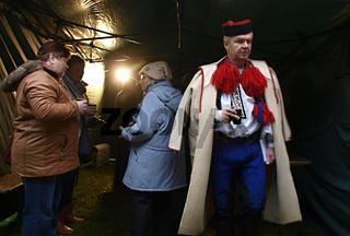 a man in a folk costume