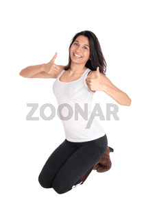 Woman kneeling with thumps up.