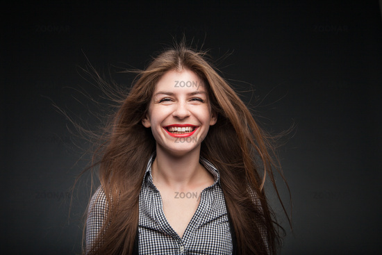 Adorable girl grins.