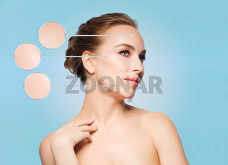 beautiful young woman touching her face
