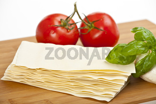 lasagna plates, basil, tomatoes and mozzarella