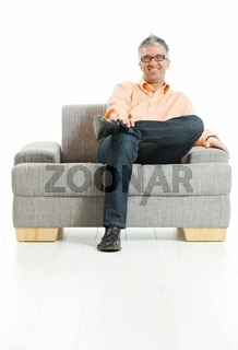 Happy man sitting on couch
