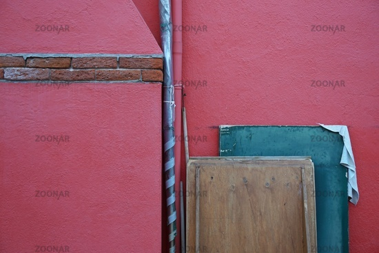 Red wall and wooden tiles