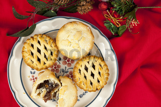 Plated mince pies at christmas on a red table cloth