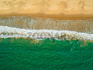 Aerial View Amazing Seascape with Small Waves on Sandy Beach