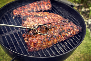 Barbecue Pork Spare Ribs as close-up on a kettle grill