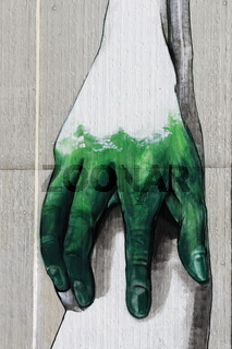 Wall with graffiti - Hand reaches out  from a concrete wall