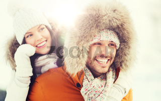 happy couple having fun over winter background
