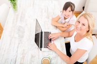 Mother and Daughter with a Laptop at home