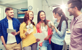 creative team on coffee break talking at office