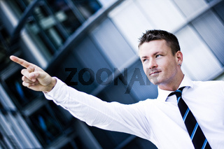 Photo Of A Handsome Man In A Corporate Attire Pointing Up