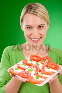 Healthy lifestyle - woman with caprese salad