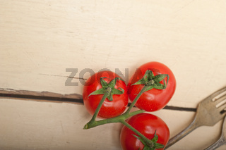 ripe cherry tomatoes over white wood