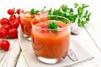 Soup tomato in two glasses on board