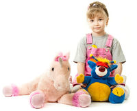 Girl surrounded by her toys
