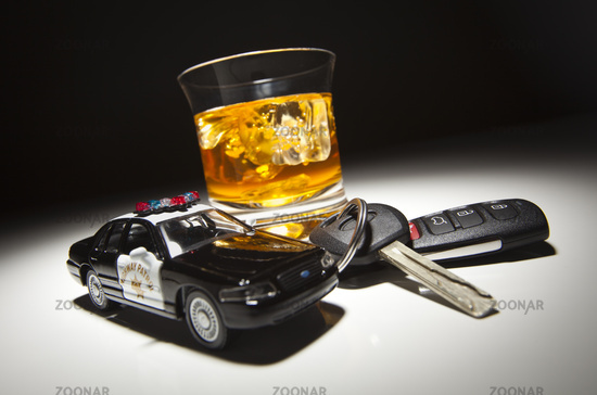Highway Patrol Police Car Next to Alcoholic Drink