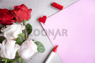 Roses bouquet and blank paper sheet