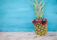 Pineapple with heart shaped glasses