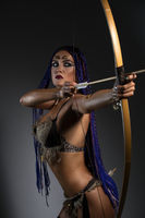 Sexy horsewoman shooting arrows portrait