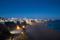 Scenic twilight evening view over the Praia dos Pescadores, Fishermen Beach in Albufeira, Algarve Portugal