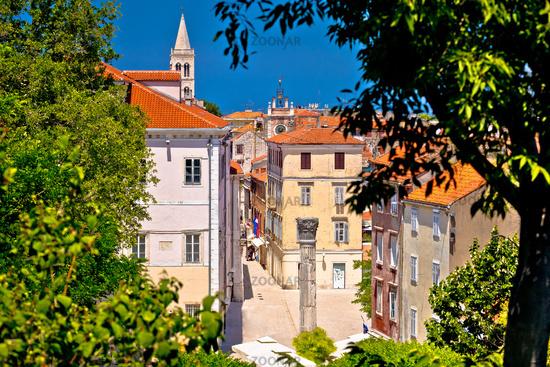 Kalelarga and historic Zadar landmarks view through green frame