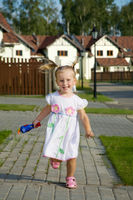 Running little cheerful girl