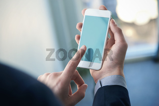 Mock up of a man holding smartphone. Clipping path