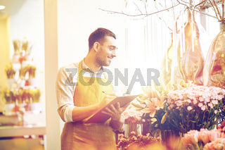 florist man with clipboard at flower shop