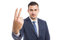 Businessman showing number two with fingers