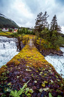Suspension bridge over the mountain river, Norway.
