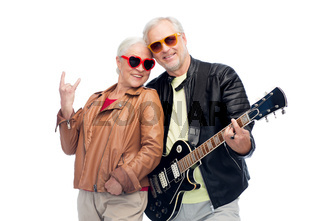 senior couple with guitar showing rock hand sign
