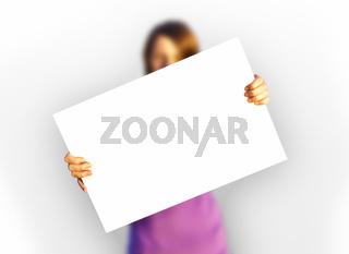 girl holding white paper