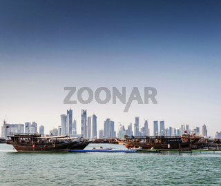 doha city urban skyline view and dhow boat in qatar
